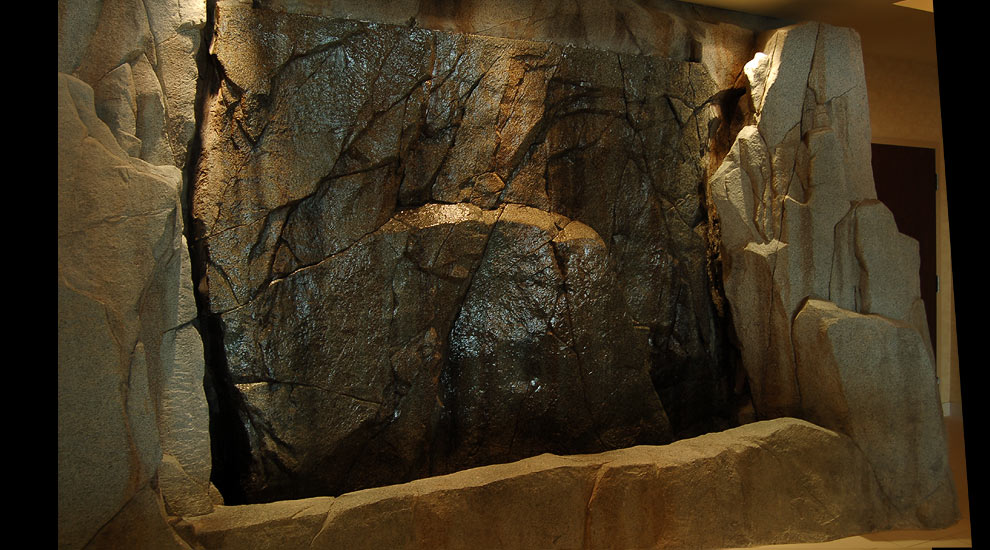 A custom rockwork indoor waterfall.