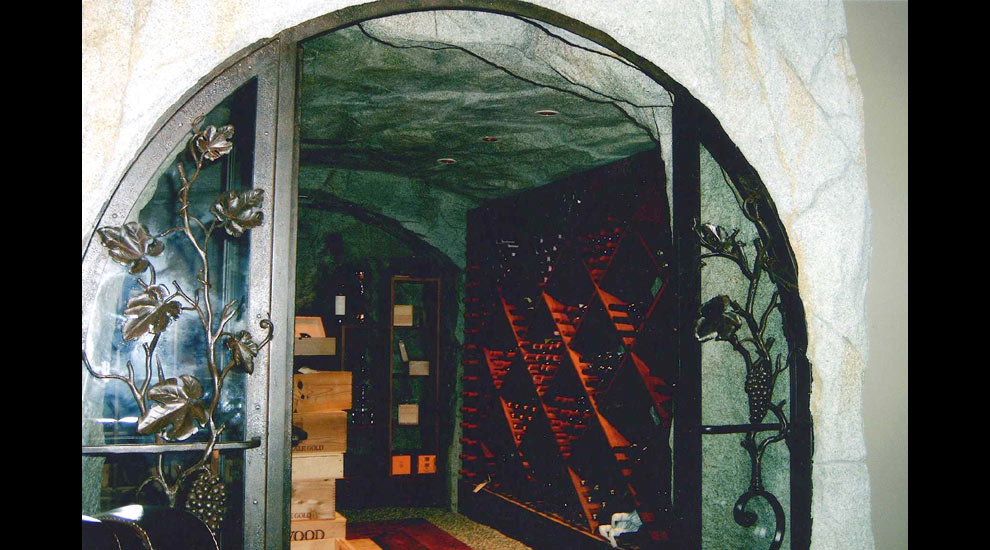 Custom Wine Cellar integrating wrought iron and rockwork.